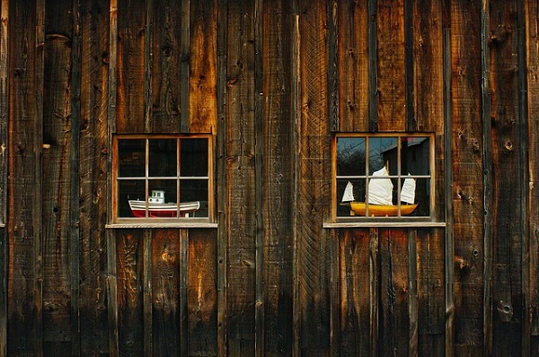 wood windows with boats