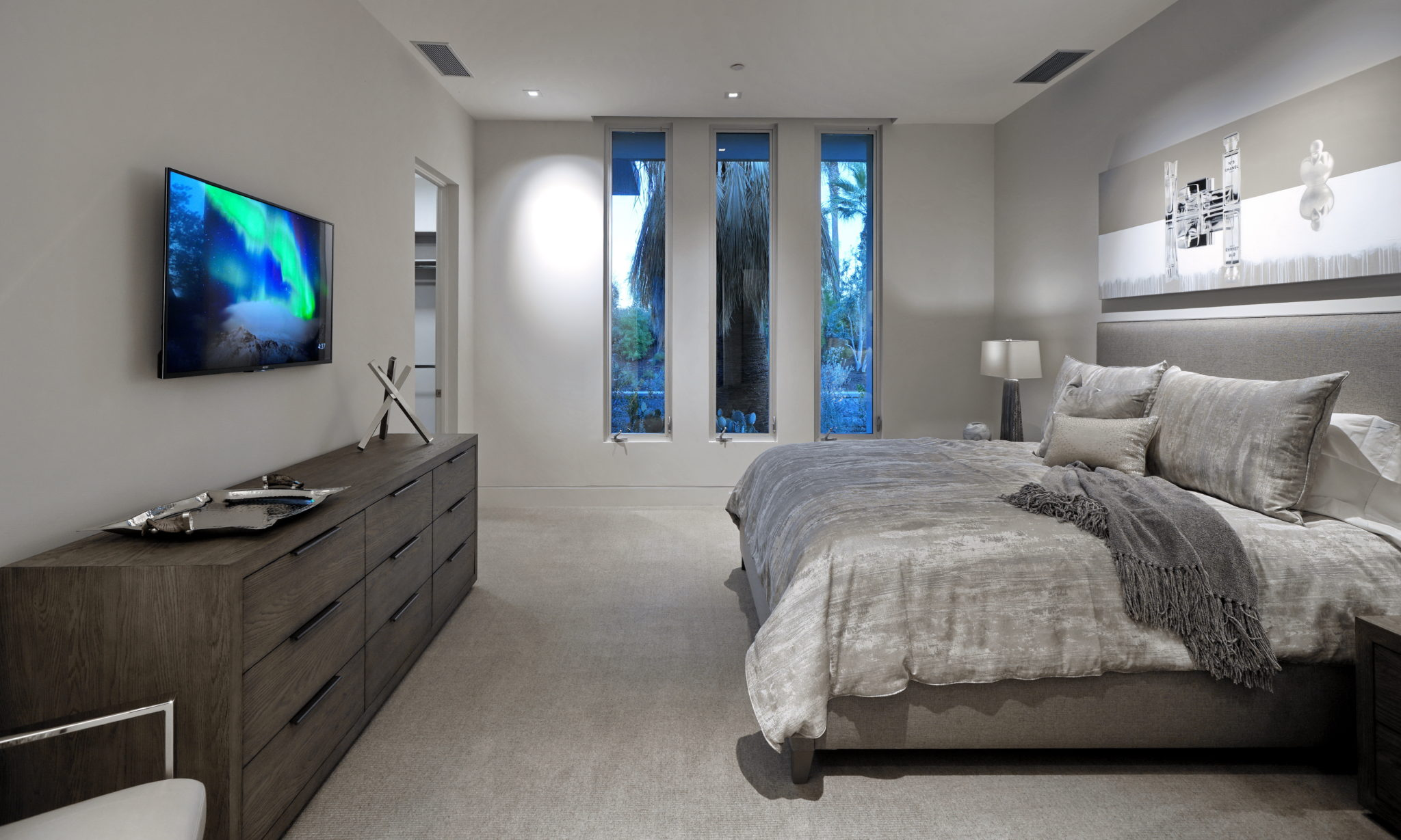 Modern bedroom with windows on the background