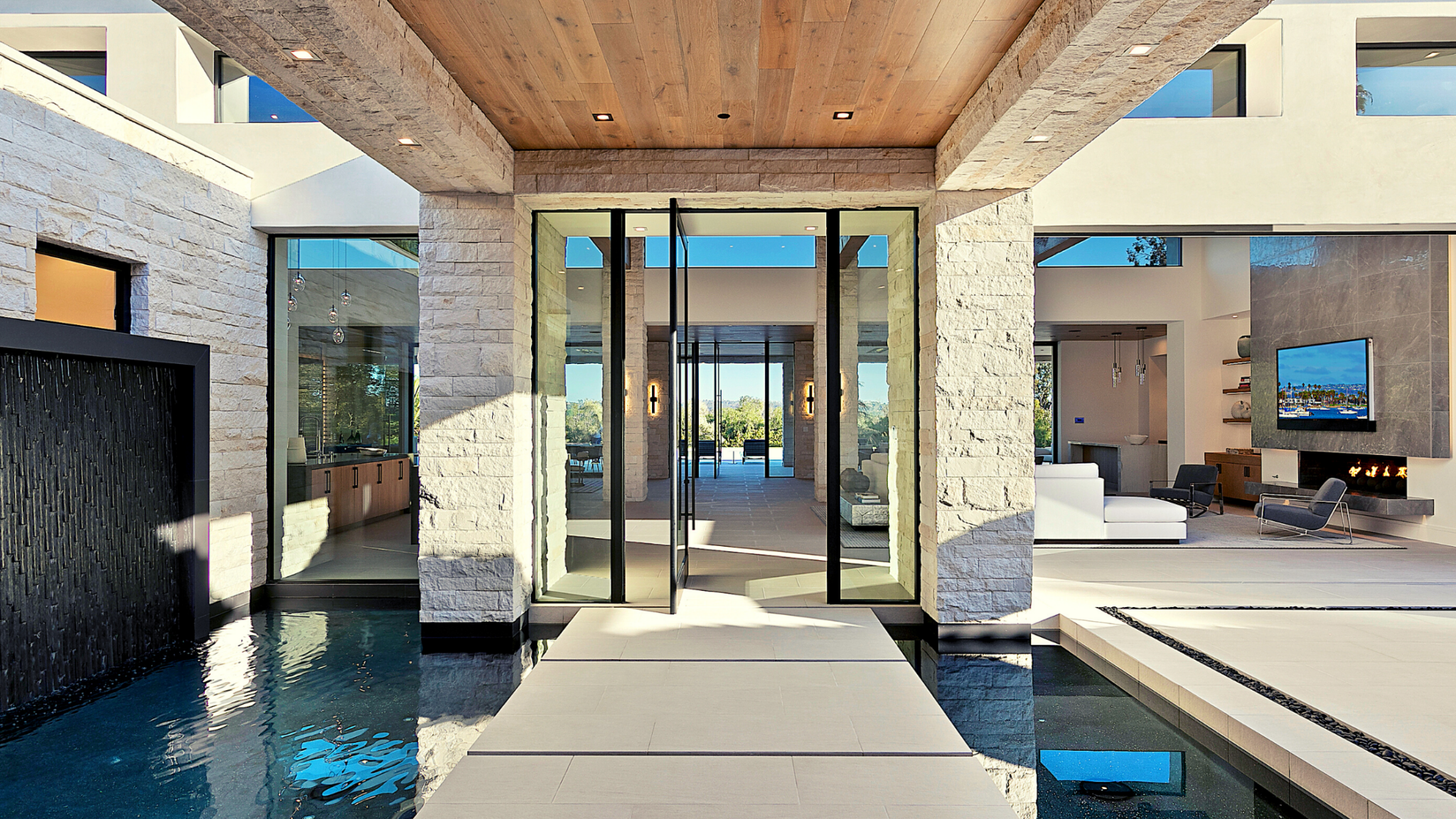 Modern home entryway at Rancho Santa Fe project by Jensen Door Systems (dealer) and Munsch Homes (builder)